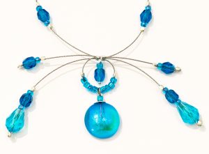 Fireworks necklace array in Capri Blue